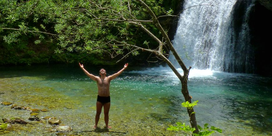 Mt Olympus; brave hiker takes his bath in the beautyful cold waters of Enippeas Gorge.