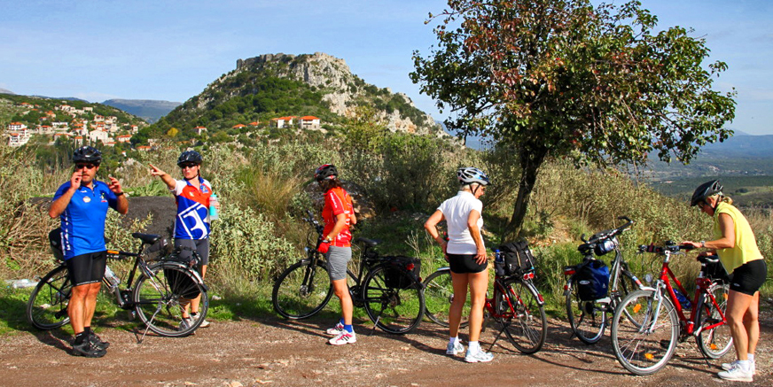 Arcadia; bikers near the medieval castell of Karitena.