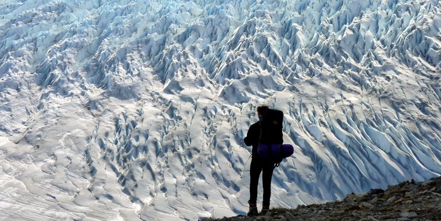 Brave trekker in Chilean Patagonia hiking towards the Grey Glacier.